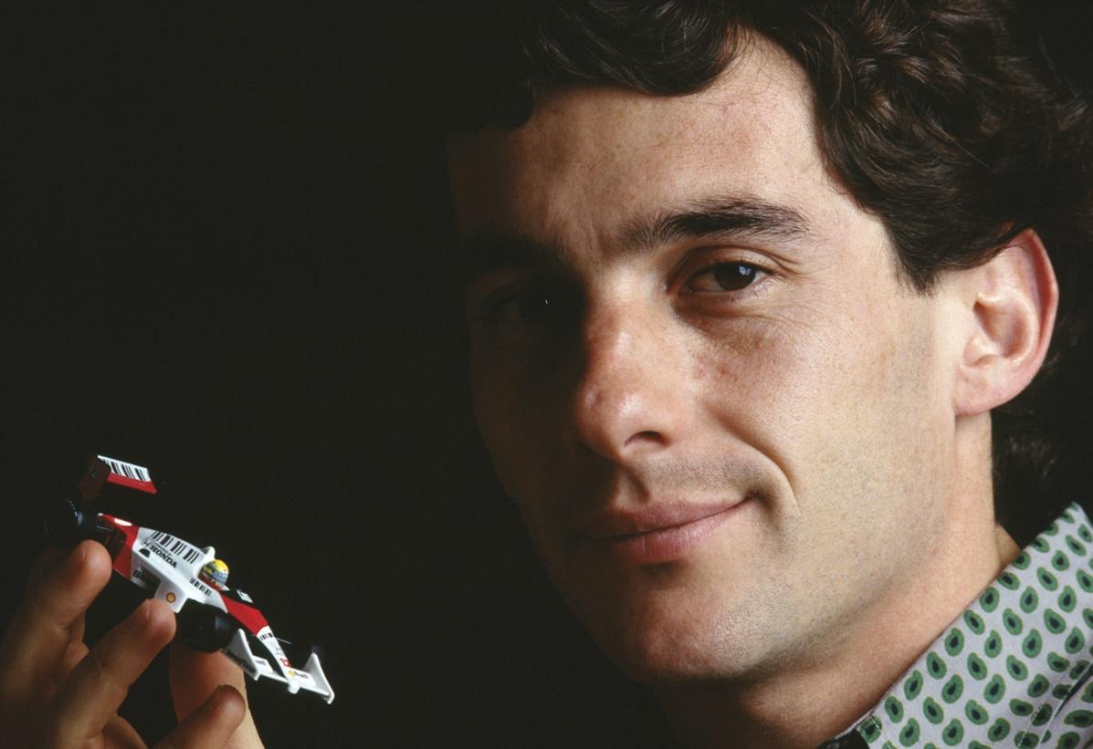 Ayrton_Senna_with_toy_car_cropped_no_wm