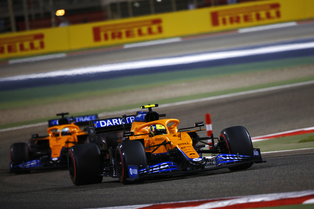 Lando Norris, McLaren MCL35M, leads Daniel Ricciardo, McLaren MCL35M front on