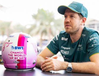 Pink BWT crash helmet design for Sebastian Vettel